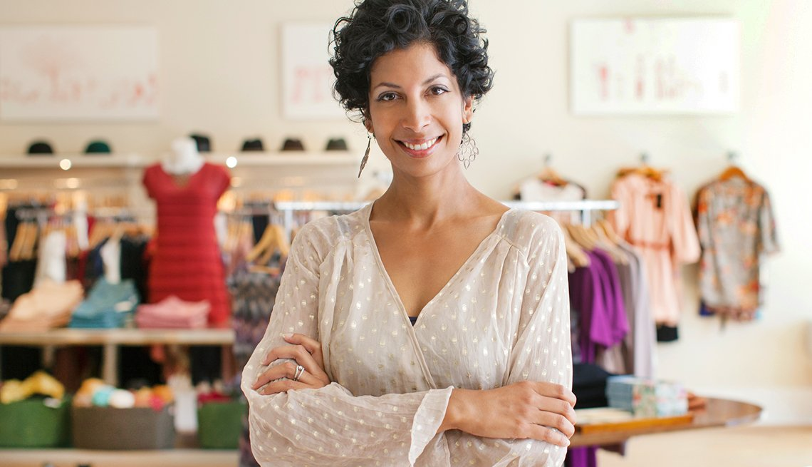 an older small business owner in her boutique
