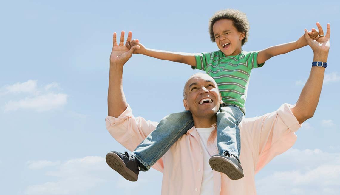 Father carrying grandson on shoulders, Retire happy