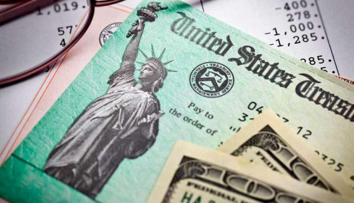 treasury check bill and 100 dollar bills