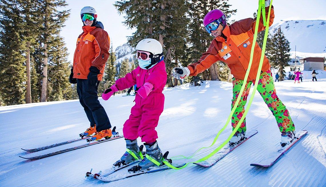 ski instructors help child ski