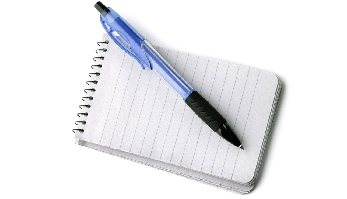 Travel Tips for People With Hearing Loss - Notebook and ballpoint pen