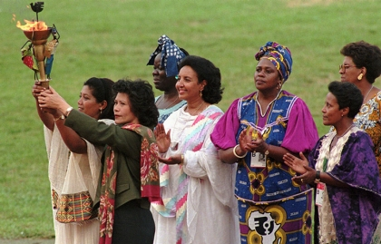 Women representing the different cultures of the world hold the