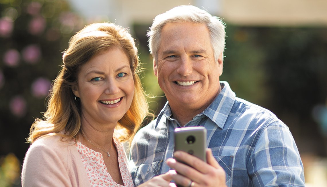 Smiling Couple Looking at Phone