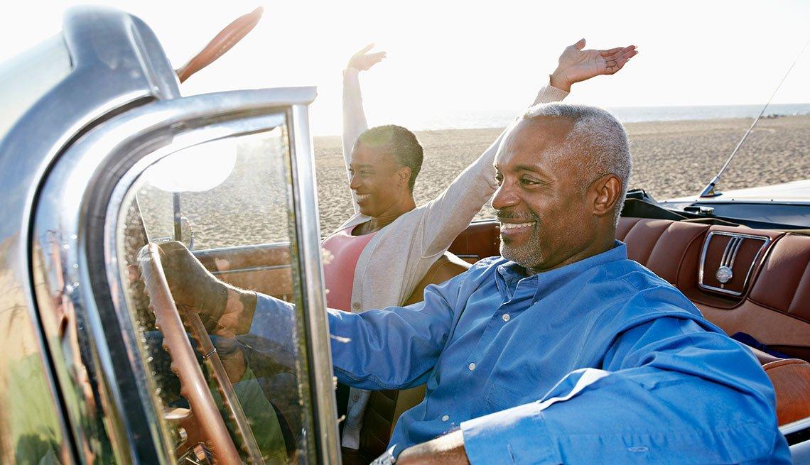 Couple Driving Vintage Car near Beach, AARP Member Benefits Insurance
