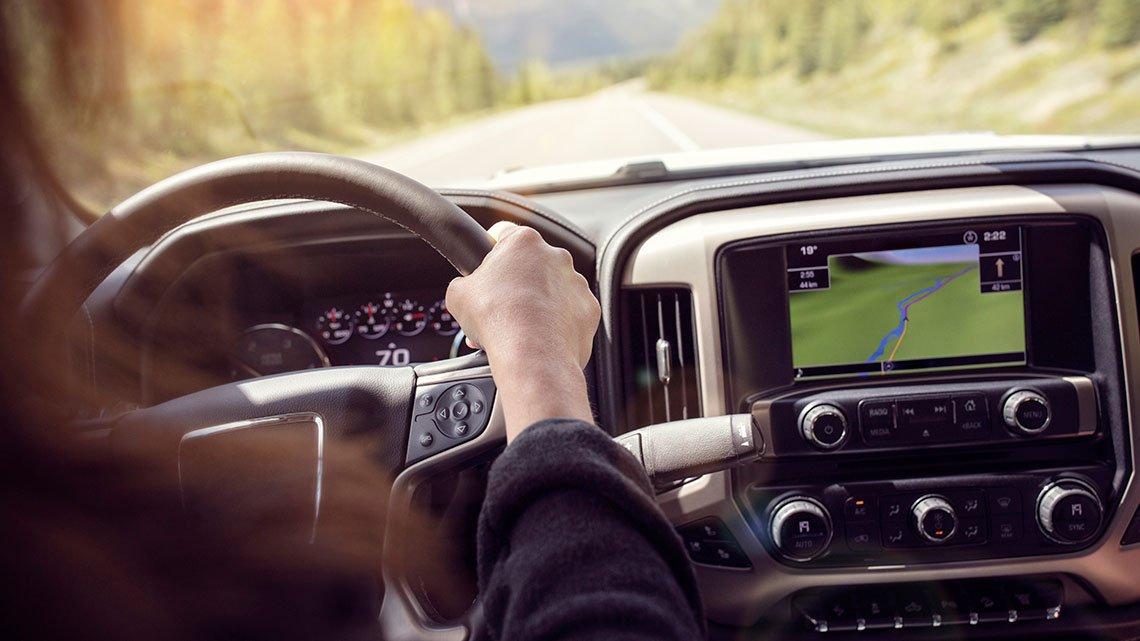 Woman holding steering wheel