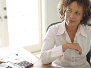 Mature woman sitting at her desk