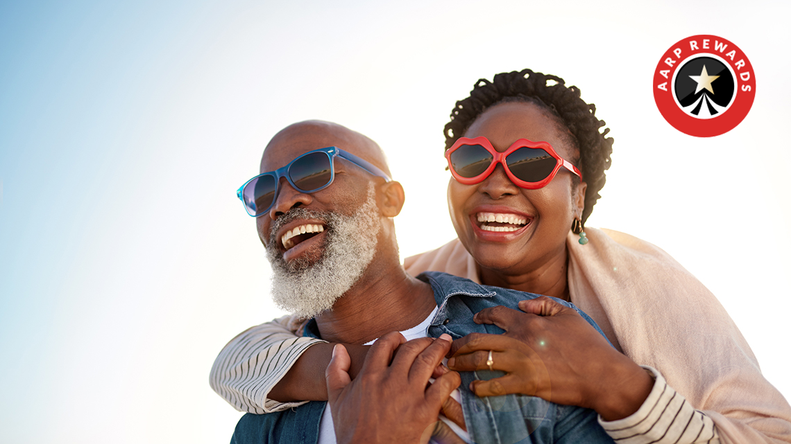 Energetic African American couple with sunglasses