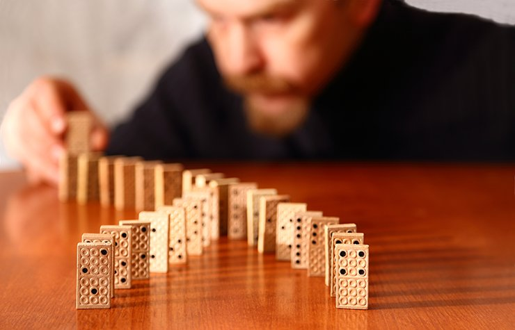 Mature adult playing dominos