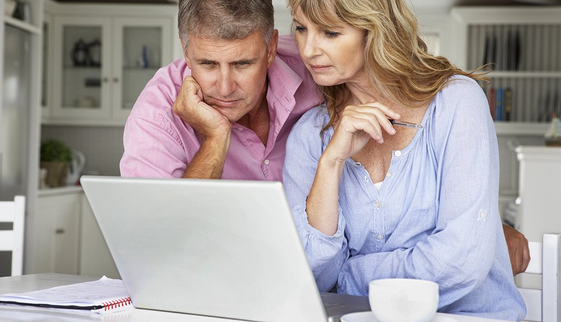 couple working home on computer