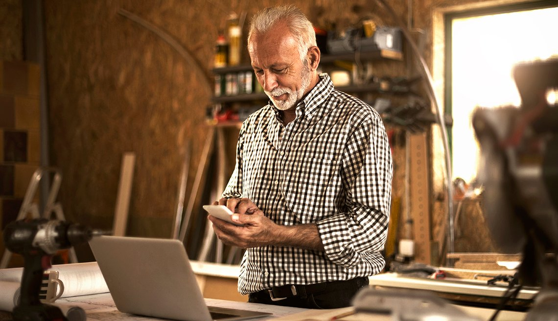 A man using his smartphone at home