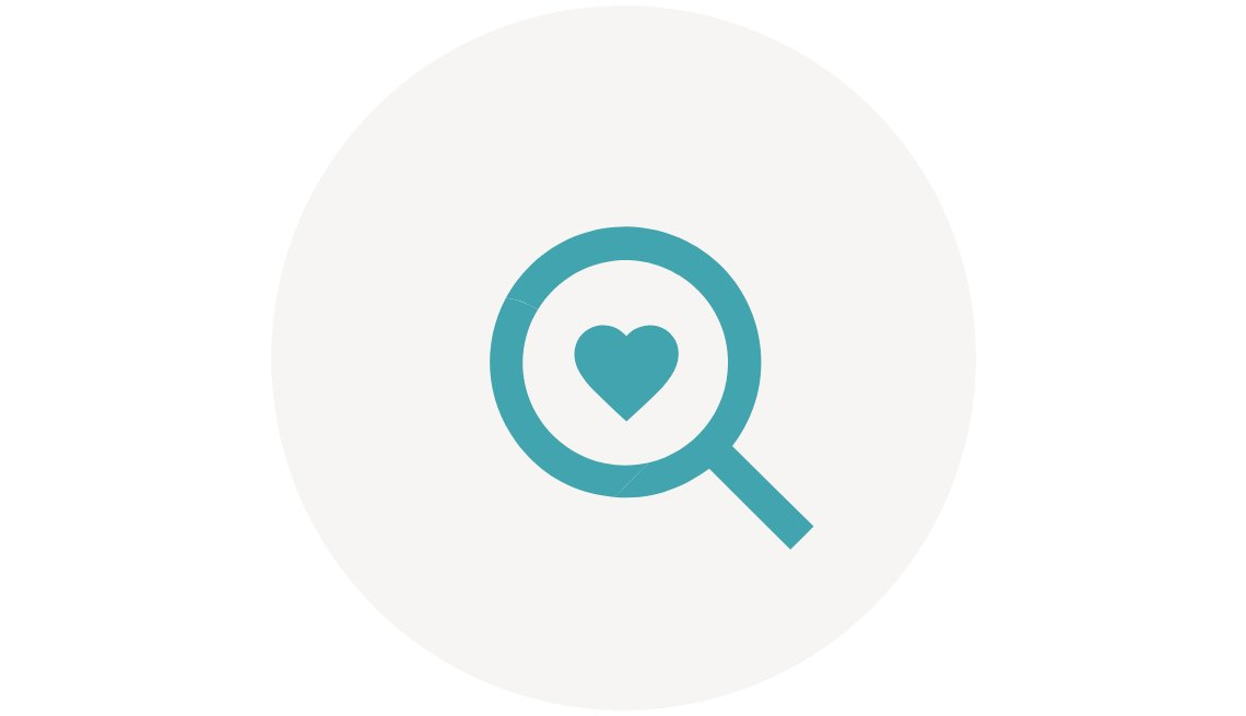Caregiving Community Resource Finder Icon. A heart inside a magnifying glass