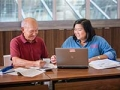Tax-Aide volunteer Donna Ortega assists a participant with his taxes