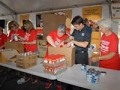 Jeff Gordon helps volunteers box up food for the hungry