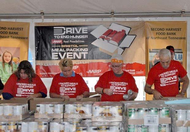 Jeff Gordon Helps Pack Meals At Bristol Drive To End Hunger Event Aarp Foundaton