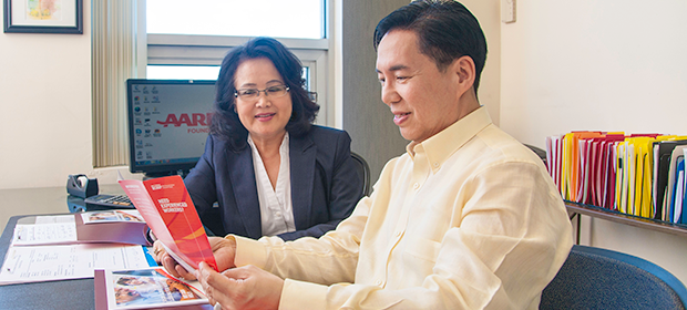 Man and woman looking at brochures - AARP Foundation SCSEP