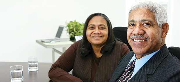 SCSEP Employer - Latino male and female sitting at desk