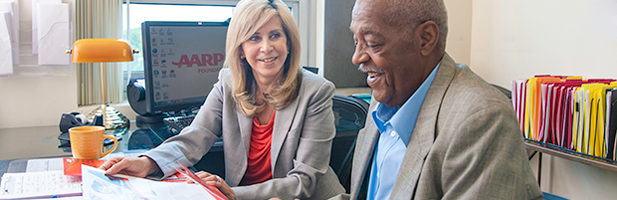 Man and woman looking at paperwork - AARP Foundation SCSEP
