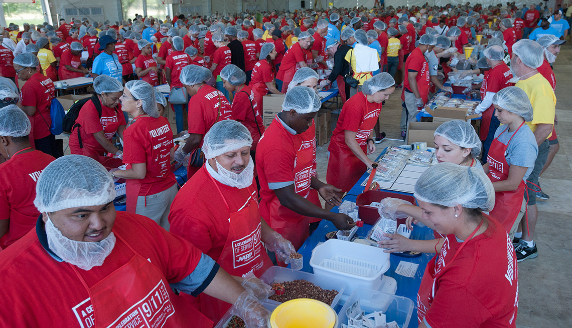 "Volunteers pack meals during AARP Foundation's ""A Celebration of Service"" event on the National Mall in Washington, D.C. on Friday, September 11, 2015."