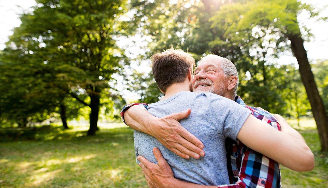 Mature man embracing younger man