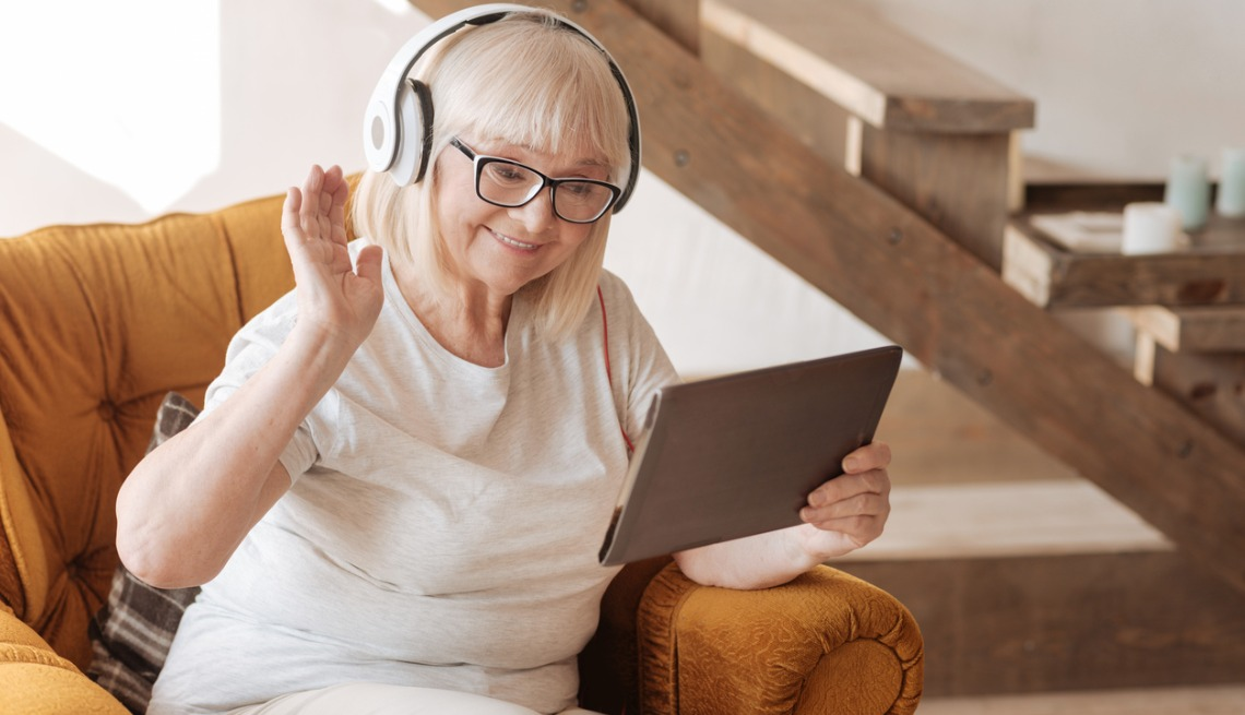 Happy delighted woman participating in online learning