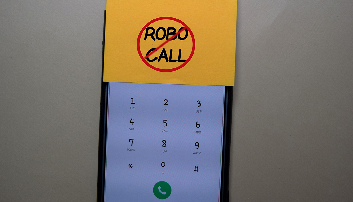 the screen of a mobile phone with a sticky note on it that says no robo calls