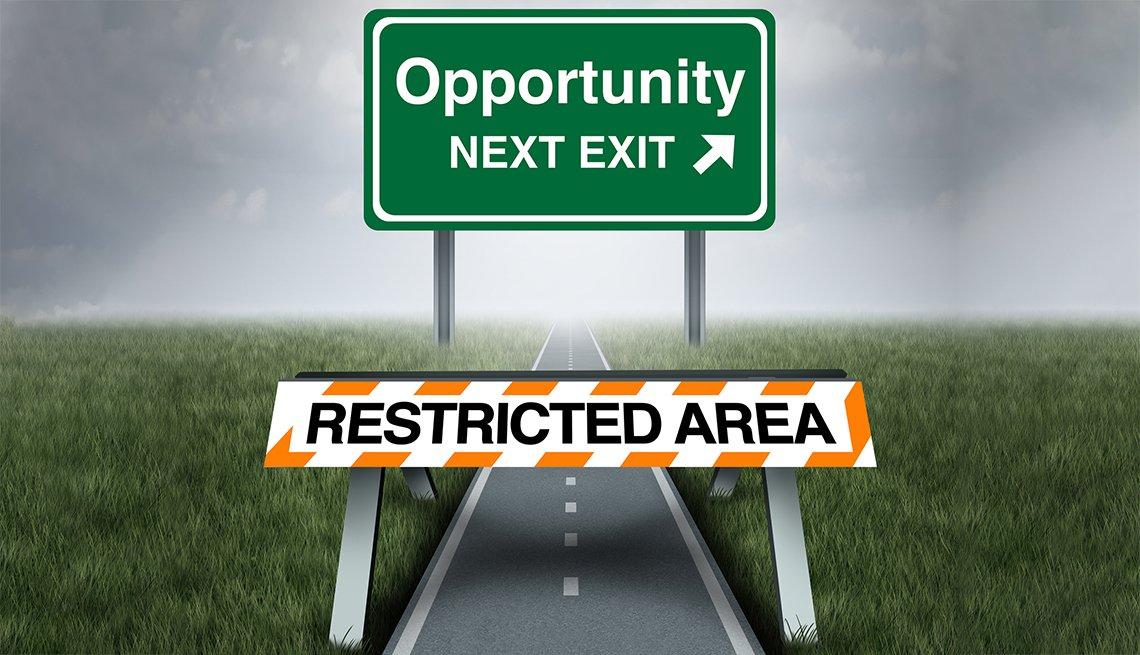 a road sign that reads opportunity next behind a road sign that reads restricted area