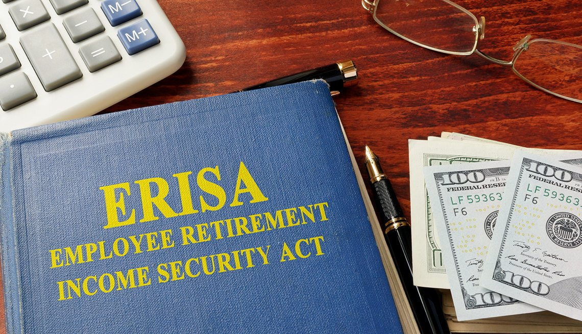 a book on a table titled e r i s a employee retirement income security act