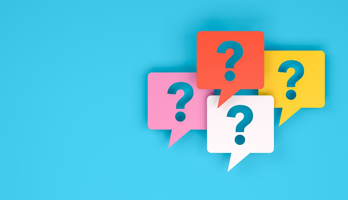 four question marks in speech bubbles on a blue background