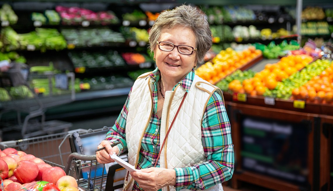A woman in the supermarket produce isle