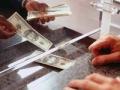 send money, elder watch (Duncan Smith/Corbis)