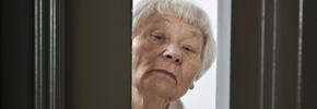 woman at door, elder watch (Istockphoto)