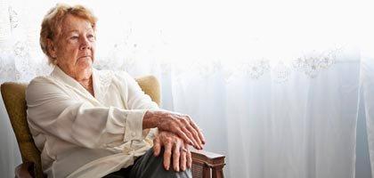woman in chair, elder watch (Istockphoto)