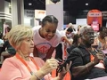 Atlanta Life@50+ event, Anijarae Dade helps seniors use tablet