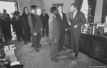 President John F. Kennedy greets the inaugural group of Peace Corps volunteers at the White House, August 1961. (Time & Life Pictures/Getty Image)