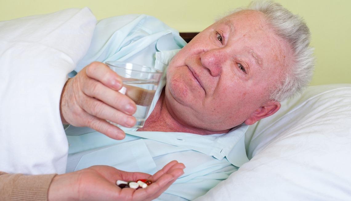 Bedridden man with medications