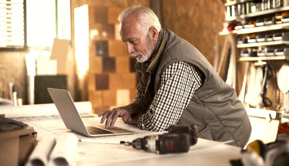 mature man looking at laptop
