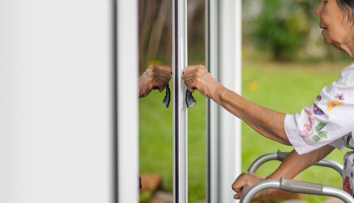 woman opening door with key