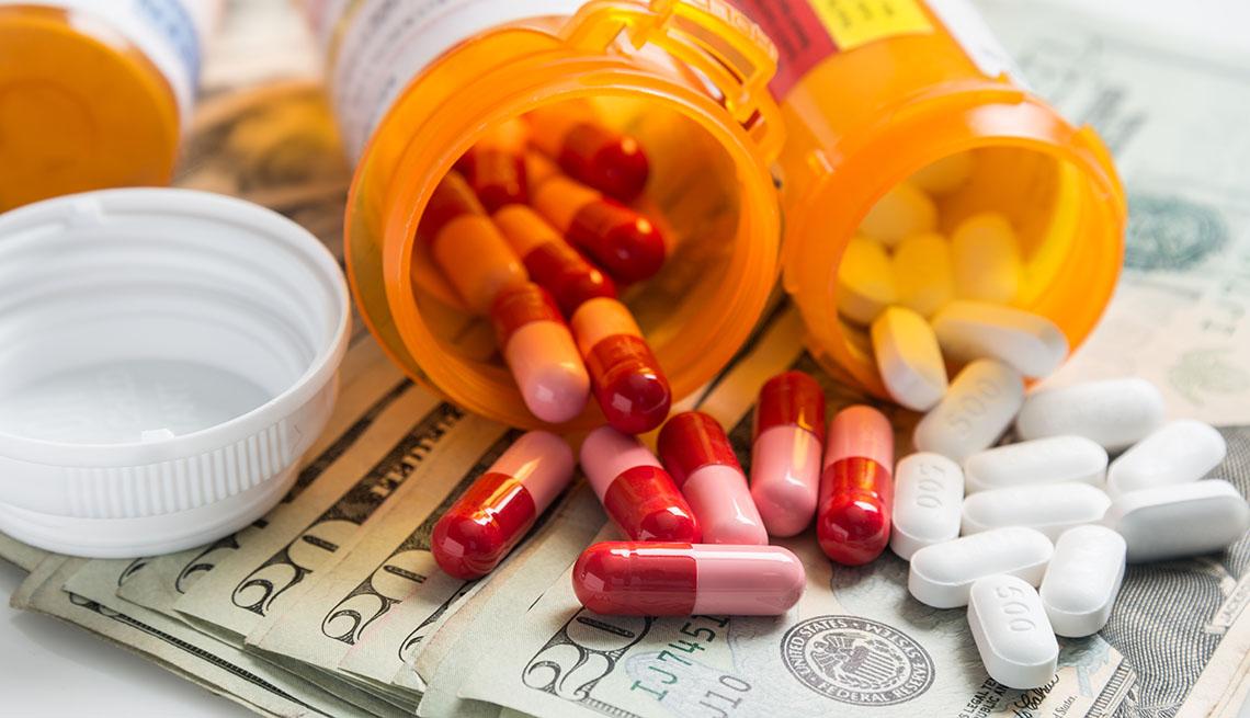 Bottles of prescription drugs and money