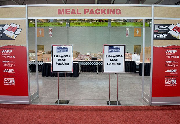 Entrance of the meal packing area of the AARP Life@50+ event in Boston.