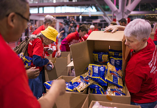 Members packing food boxes during the AARP Life@50+ event in Boston.