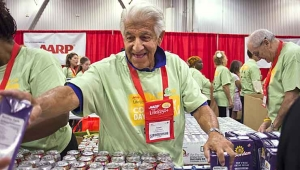 Drive to End Hunger volunteer Robert Fraleigh helps pack meals at a recent event