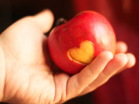 AARP Foundation funds grants to help solve the problem of hunger among senior citizens- a heart carved into an apple