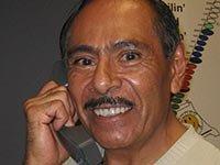 HSC volunteer Dario Damian makes a call to an at-risk homeowner