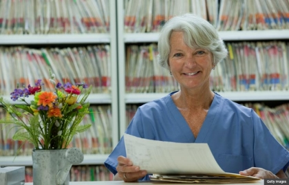 Nurse checking medical records. Back to work at 50+ (Getty Images)