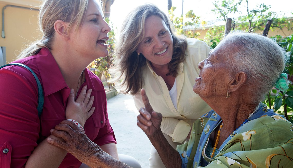 Debra Whitman, AARP Foundation President Lisa Ryerson, Mirta Pierre, 90, St. Vincent de Paul nursing home, Leogane, Haiti