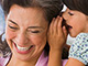 Girl whispering into someone's ear, Hearing resource center