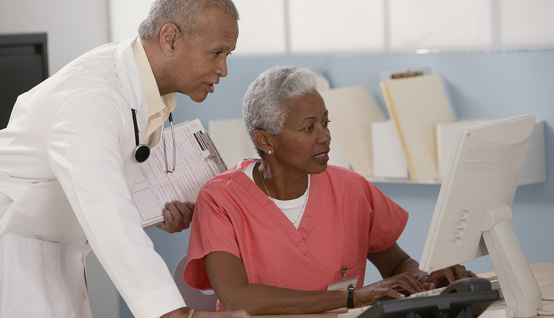 Senior man and woman, Medical team consulting at computer, Medical office, Back to Work, 50 plus, AARP Foundation, Our Work