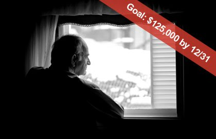 Man looking out of window, Goal: $125,000 by 12/31