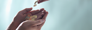 Coins flowing from one person's hands to another's hands