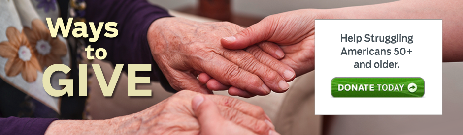A younger person's hands reaching out to an older person